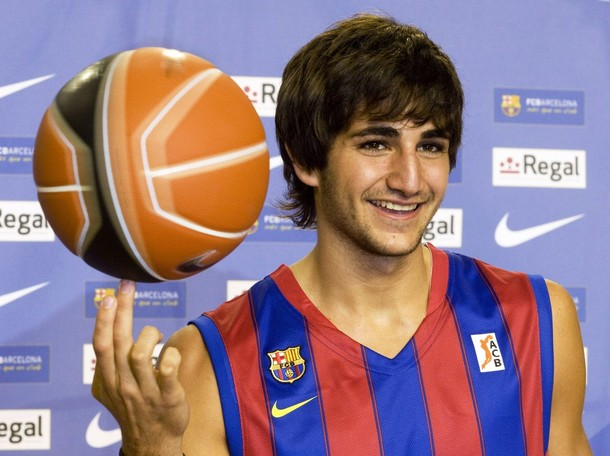 Barcelona's basketball new signing player Ricky Rubio poses before a news conference at Nou Camp in Barcelona
